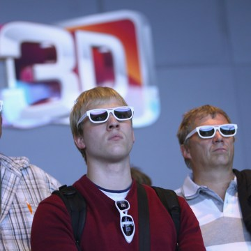Visitors wear 3D glasses while watching a presentation of 3D Smart TV at the LG stand at the IFA 2011 consumer technology trade fair on the first day of the fair's official opening on September 2, 2011 in Berlin, Germany.