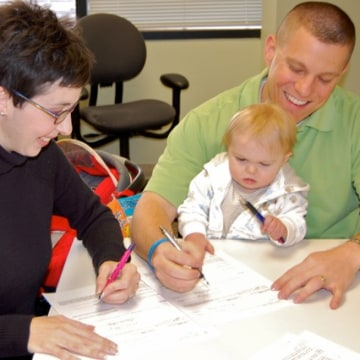 Signing Grayson's adoption papers in late 2010.