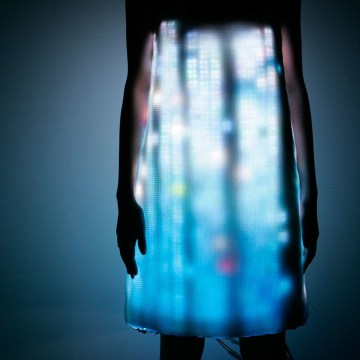 A model poses in an LED dress in Tokyo. The dress, with light-emitting diode devices installed inside, was designed by Swarovski and Hussein Chalayan ...