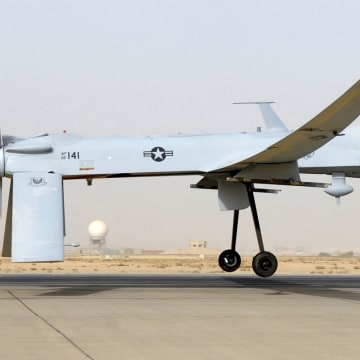An MQ-1B Predator from the 46th Expeditionary Reconnaissance Squadron takes off from Balad Air Base in Iraq.