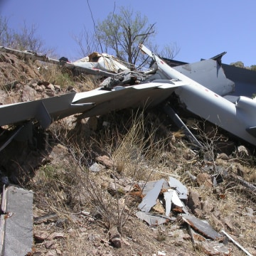 "The remains of a Predator B, ""Reaper"" drone, sprinkled across the Arizona mountainside."