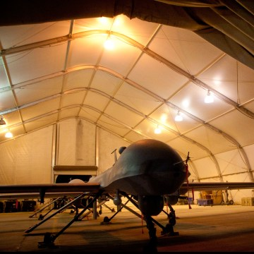 MQ-1B Predator unmanned aerial vehicles sit in a clamshell at night at Kandahar Airfield, Afghanistan, July 31, 2011.