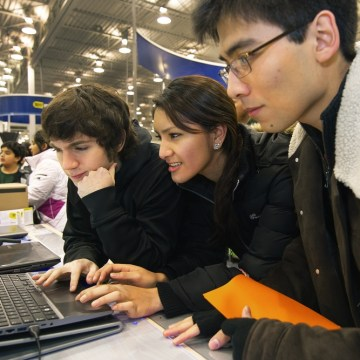 "Black Friday shoppers check out a Samsung I-Core 7 laptop on sale at the Fair Lakes Best Buy store in Fairfax, Va., in this Nov. 25, 2011, file photo. Retailers are fighting ""showrooming,"" in which shoppers check out items in stores but then buy elsewhere online. Analysts like Best Buy's store-within-a-store concept, which lets customers interact with products and ask questions of dedicated salespeople."