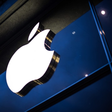 The Apple logo is attached to the facade of the Apple Store in Hamburg, Germany.