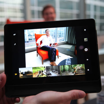 larger 8.9-inch Kindle Fire HDX has a back-facing 8-megapixel camera that automatically engages when you slide the tablet upwards in its case
