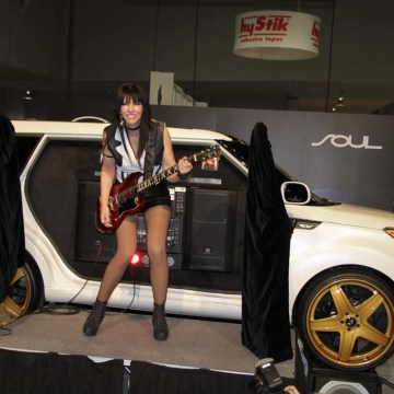 Rocker Leona X is seen here with the Kia Soul at the 2013 SEMA Show in Las Vegas. The auto industry is adapting to a younger generation of car buyers for whom customization is key.