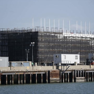 "A barge built with four levels of shipping containers is seen at Pier 1 at Treasure Island in San Francisco.Plans call for it to become an ""unprecedented artistic structure"" that will move around the bay by tugboat."