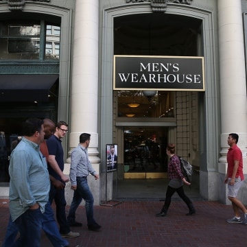 SAN FRANCISCO, CA - OCTOBER 09:  Pedestrians walk by a Men's Wearhouse retail store on October 9, 2013 in San Francisco, California.  Men's clothing r...