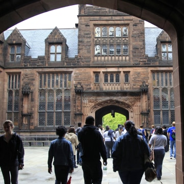 A group walks on a tour at Princeton University Wednesday, May 9, 2012., in Princeton, N.J. (AP Photo/Mel Evans)