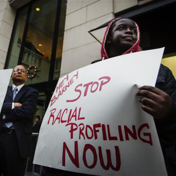 Demonstrators stand in front of a Barneys luxury department store Oct. 30 with signs decrying allegations that Barney's and Macy's stores have unfair security policies aimed at minorities. A report that Barneys requested found the store had no written or unwritten policies to profile customers based on race.