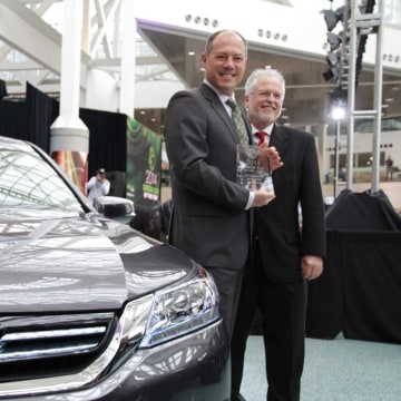 Mike Accavitti, marketing chief for American Honda, left, and Ron Cogan, publisher of Green Car Journal, with a 2014 Honda Accord, the Green Car of the Year.