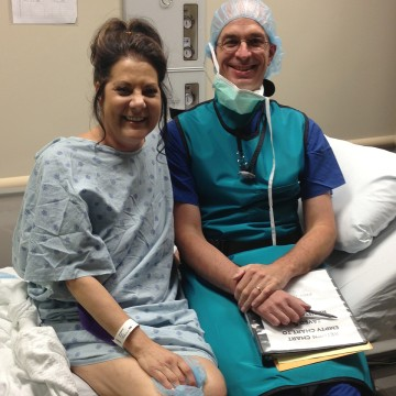 Susan Adcock, left, visits with Dr. Stuart Russell, chief of heart failure and transplantation at Johns Hopkins Hospital in Baltimore.