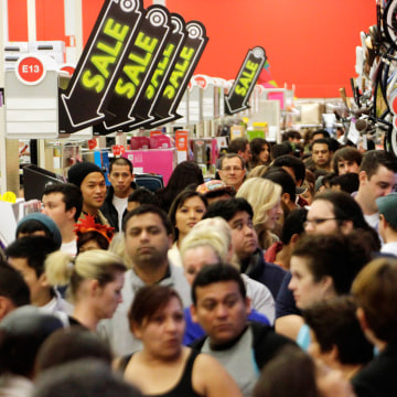 A crowd of shoppers browse at Target on the Thanksgiving Day holiday in Burbank, California in this November 22, 2012, file photo. Opening their doors...