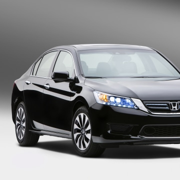 This undated publicity photo provided by American Honda Motor Co., Inc. shows the 2014 Honda Accord Hybrid. Honda says the hybrid, which goes on sale ...