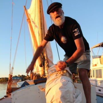 Capt. Steve Schwartz works aboard Ceres at the Burlington Boathouse in Burlington Vt., on Sept. 27, 2013.
