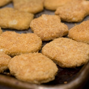 Chicken nuggets, fresh from the oven, are seen in this May 2, 2010 photo. Kids love chicken nuggets, but Consumer Reports says watch out for fat and s...