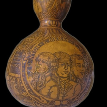 A gourd emblazoned with heroes of the French Revolution said to contain the blood of Louis XVI.