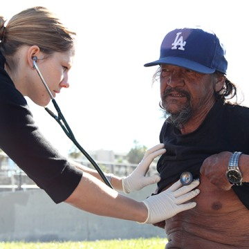 """Carrie Kowalski, a physician assistant at the Venice Family Clinic in Venice, California, checks """"Tarzan"""", one of the homeless patients she seeks ..."""