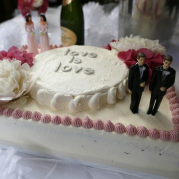 A wedding cake at a reception for same sex couples is seen at The Abbey in West Hollywood, Calif., July 1, 2013. Wedding businesses that don't serve gay couples can feel the impact, both negative and positive.