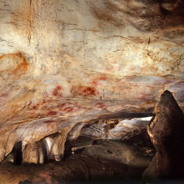 The Panel of Hands in El Castillo Cave near the village of Puente Viesgo is seen in this handout photo released June 14, 2012.  Scientists using a new...