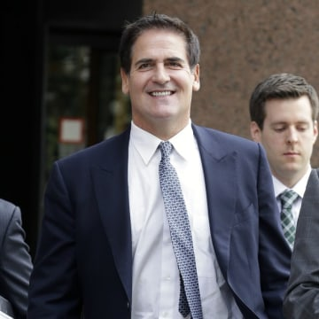 Dallas Mavericks NBA basketball team owner and businessman Mark Cuban walks out of the federal courthouse during a break in testimony during his insid...