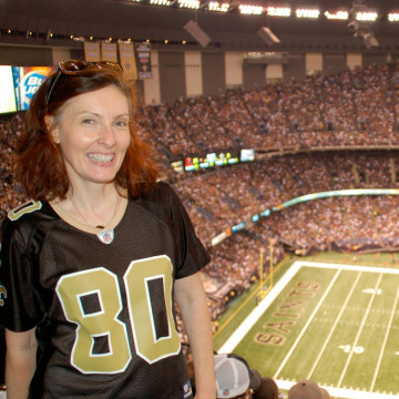 Lynda Woolard, a diehard New Orleans Saints fan, believes the NFL should receive no tax exemption. Her online petition to strip that tax break from the league has garnered more than a quarter million signatures. She's wearing a Jimmy Graham jersey at the Superdome.