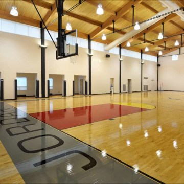 Among the many amenities in Michael Jordan's home is a full-size basketball court with locker room and viewing area.