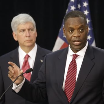 State-appointed emergency manager Kevyn Orr, right, and Michigan Gov. Rick Snyder address the media during a news conference in Detroit in this July 19, 2013, file photo. The city's bankruptcy case goes to trial Wednesday.