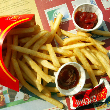 NEW YORK - SEPTEMBER 3:  French fries are shown in a McDonald's restaurant on First Avenue September 3, 2002 in New York City. McDonald's announced pl...