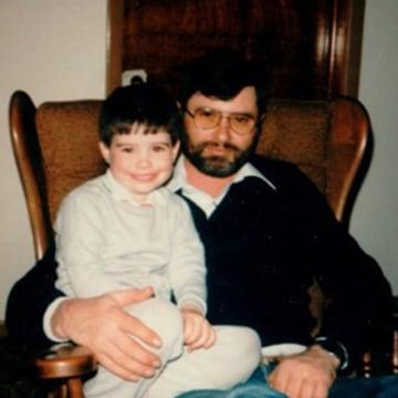 Image: Brandon Curtis sits on dad Brian Curtis' lap in 1987.