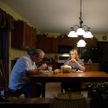 Mark and Kristine Jockel eat chili dinner at their home Wednesday, October 30, 2013 at their home in Monaca, Pa.                   Julia Rendleman/Getty Images