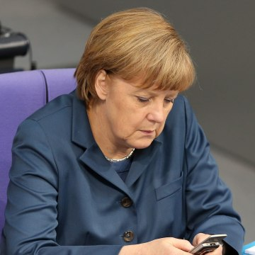 epa03927009 (FILE) A file picture dated 18 April 2013 shows German Chancellor Angela Merkel with her mobile phone in the German Bundestag parliament i...