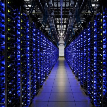 epa03439161 An undated handout photo provided by Google on 19 October 2012 shows blue LEDs on a row of servers showing that everything is running smoo...