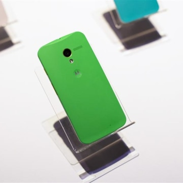 Different colored examples of Motorola's new Moto X phones rest on a table at a launch event in New York, in this August 1, 2013, file photo. REUTERS/...