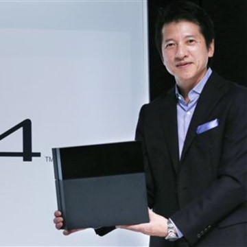 Hiroshi Kawano, Sony Corp.'s chief of the game business in Japan and Asia, holds a PlayStation 4 during an event in Tokyo, Monday, Sept. 9, 2013. Sony...
