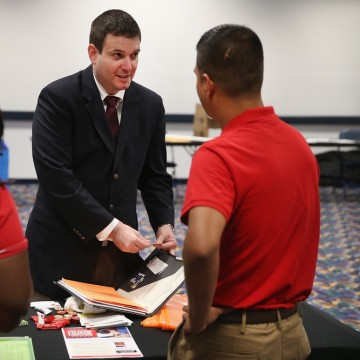 David Bynum, an Air Force veteran, speaks to recruiters during a career fair for veterans hosted by the Chicago Sky WNBA basketball team on September ...