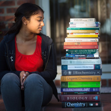 "Priya Shivraj, 21, a college student at NYU majoring in biology, Spanish and pre-med, with ""at least"" $1200 in text books from seven semesters. At hom..."