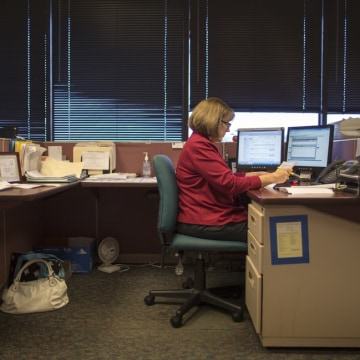 """I have basically been making the same salary since 2006,"" says Jill Fulk, seen here at her job as a customer service representitive at an insurance c..."