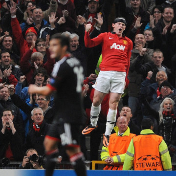 Manchester United's Wayne Rooney celebrates scoring his second goal during the UEFA Champions League match between Manchester United and Bayer Leverku...