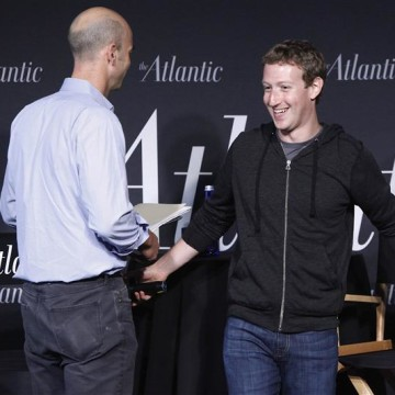 Facebook CEO Mark Zuckerberg (R) takes his seat for an onstage interview for with James Bennet (L) of the Atlantic Magazine in Washington, September 1...