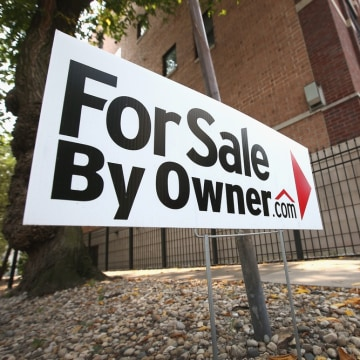 A home is offered for sale by its owner in the Ukrainian Village neighborhood on August 21, 2013 in Chicago, Illinois.