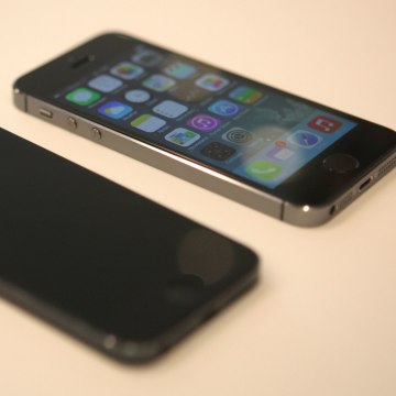 An iPhone 5S next to an older iPhone 5 at Apple's launch event in Cupertino, Calif. on Sept. 10.