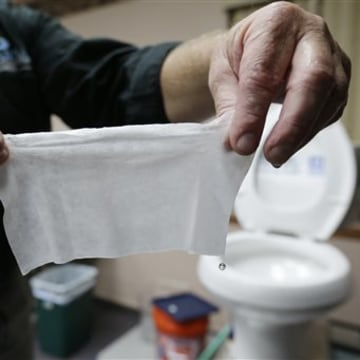 "So-called ""flushable"" wipes are clogging up sewer systems around the country. Rob Villee, executive director of the Plainfield Area Regional Sewer Authority in New Jersey, holds up a wipe he flushed through his test toilet in his office."