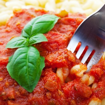 Gemelli pasta with tomato sauce and fresh basil.