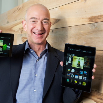 "Amazon.com Founder and CEO Jeff Bezos introduces the all-new Kindle Fire HDX 8.9"", right, and Kindle Fire HDX 7"" tablets in Seattle Tuesday Sept. 24, ..."