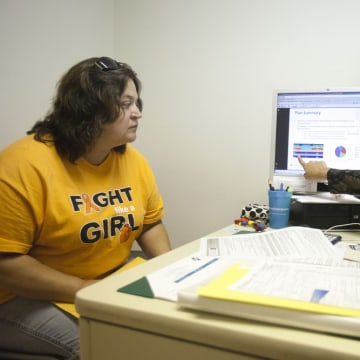 "Amy Ball, right, counsels Wanda Perry, 48, left, about possible options for health insurance in Delaware once the new exchanges open on Tuesday. Christiana Care Health System in Wilmington, Del., is providing marketplace ""guides"" to help consumers navigate the system. Perry is currently unemployed and her husband is self-employed. Neither has health insurance now."