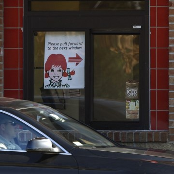 A customer pulls up to the drive thru window at a Wendy's restaurant in Marshfield, Mass., Tuesday, Nov. 8, 2011. Wendy's Co.'s third-quarter loss wid...