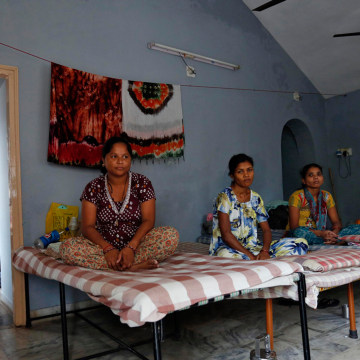 Surrogate mothers rest inside a temporary home for surrogates, provided by Akanksha IVF centre, in Anand town, about 44 miles south of the western Ind...