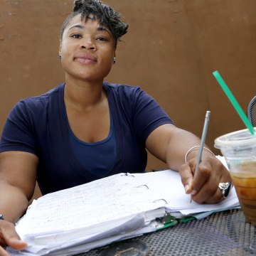 Helena Gudger, 26, pauses as she works on homework while taking a break between classes at her college in Phoenix. She wants to sign up for private health insurance as soon as the new federal marketplace opens Tuesday.