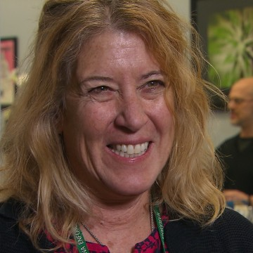 """Eva Honingford-Woolheiser, co-owner of Northern Lights Cannabis in Edgewater, Colo., says the tax revenue from marijuana will mean """"really nice schools, really nice roads and really nice bridges."""""""